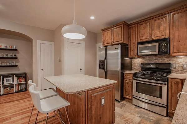 Granite Counters with Breakfast Bar and Stainless Steel Appliances