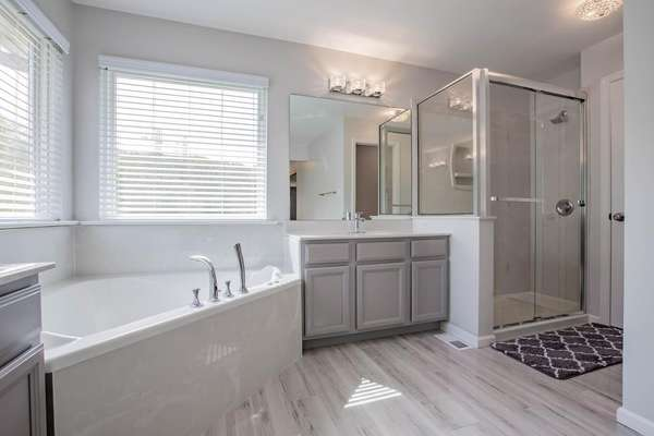 Corner Jetted Tub, Walk-in Shower, and Dual Vanities