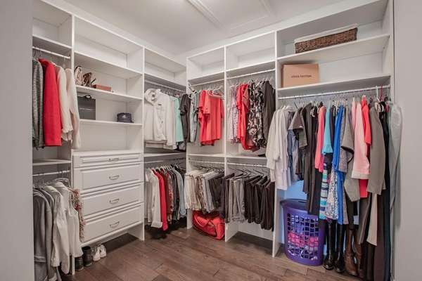 Dual Walk-in Closets with Custom Shelving
