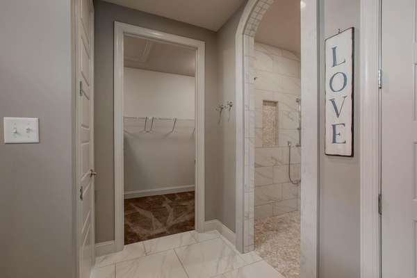 Arched Walk-in Shower and Walk-in Closet
