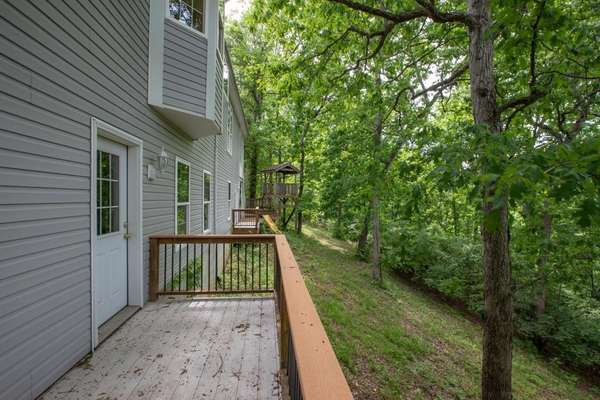 Family Room Offers Access to the Lower Level Deck