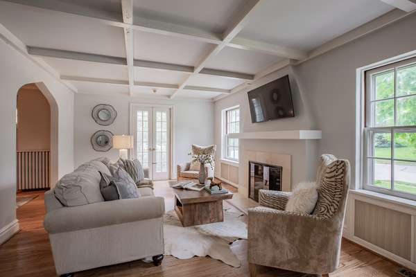 French doors to open for a pleasant breeze, and lustrous hardwood flooring found throughout the home!