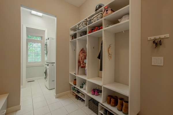 Main Floor Laundry / Utility Room with Custom Cabinetry