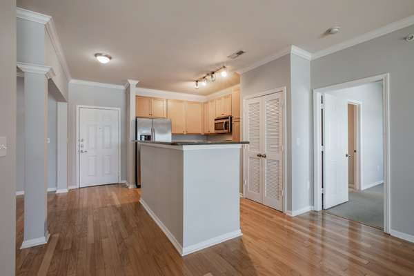 Kitchen with Granite Countertops, 42 Inch Cabinetry, and Stainless Steel Appliances