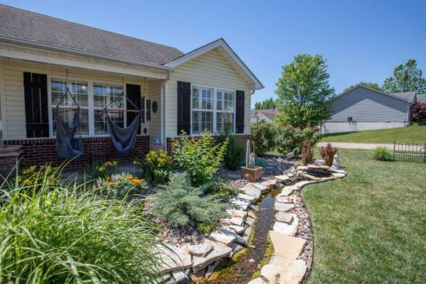 Professionally Landscaped Front Yard with a Water Feature!
