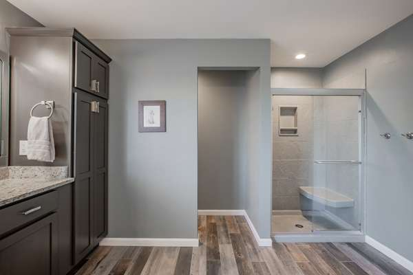 Double Vanities Topped with Granite, Tile Floors, Soaking Tub, and Separate Shower