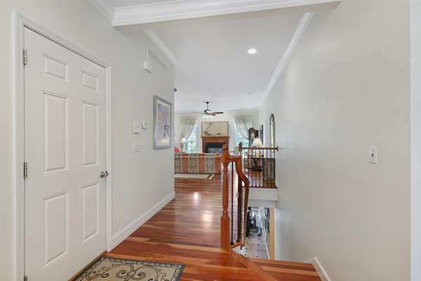 Hardwoods Continue Down the Wrought-Iron Staircase to the Lower Level!