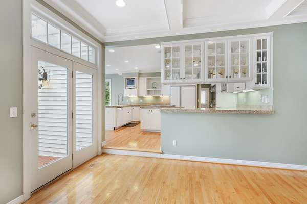 Beautiful Pass Through with Granite Counters and See Through Glass Cabinets