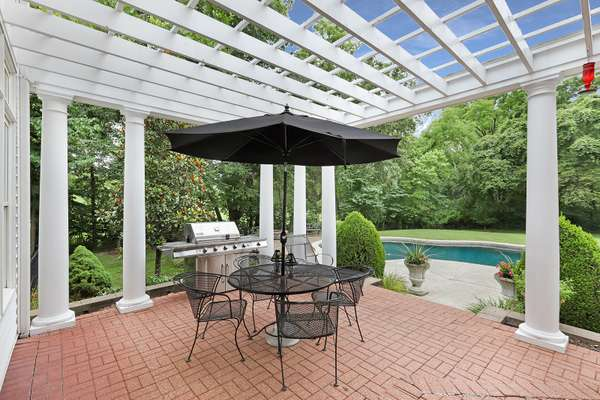 Expansive Pavered Patio with Pergola