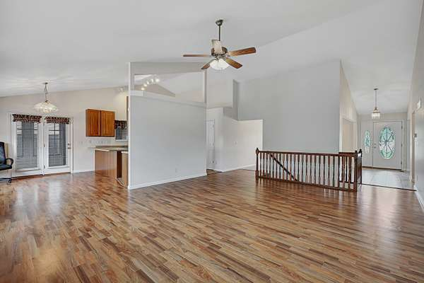 Expansive Vaulted Ceiling, Gas Fireplace, and Low-Maintenance Flooring
