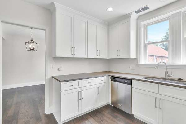 42 Custom Cabinetry, Gray Quartz Countertops, and Stainless Steel Appliances
