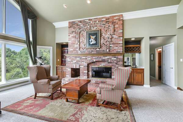 Artistic Brick Fireplace Flanked by Custom Built-ins
