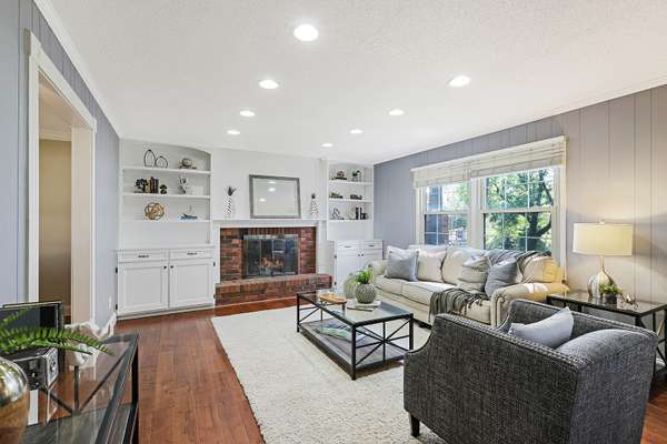 Wonderful Family Room with Wood Burning Fireplace Flanked by Custom Built-Ins