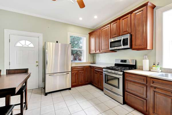 42 Inch Cabinetry with Crown Molding, and Stainless Steel Appliances