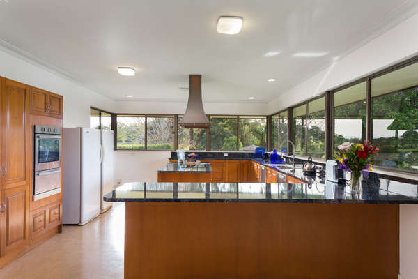 The large kitchen has expansive river and rural views. Solid timber cabinet doors.