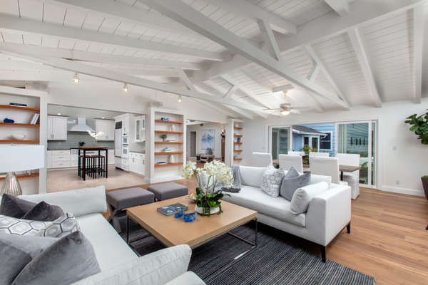 Open concept living room with high beam ceilings